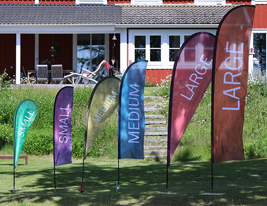 Beachflaggor i olika storlekar